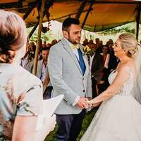 A wedding ceremony takes place at Finnebrogue Woods tipi venue